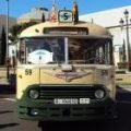 A green bus at the Barcelona classic bus rally