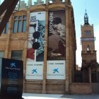 Posters hanging on the walls of the old art deco factory that houses the Caixa Forum