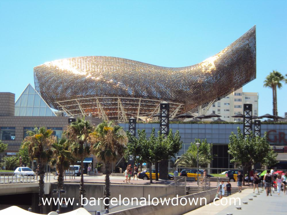 The giant fish sculpture on Barcelona's seafront shining under the summer sun.