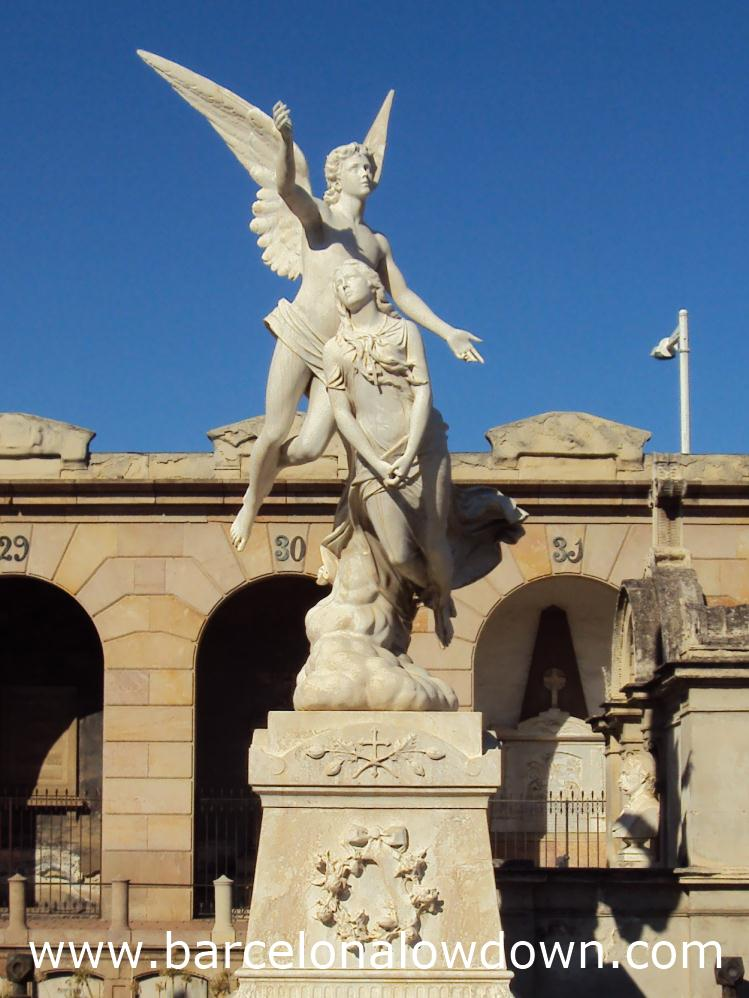 Statue of an angel carrying a woman's soul to heaven