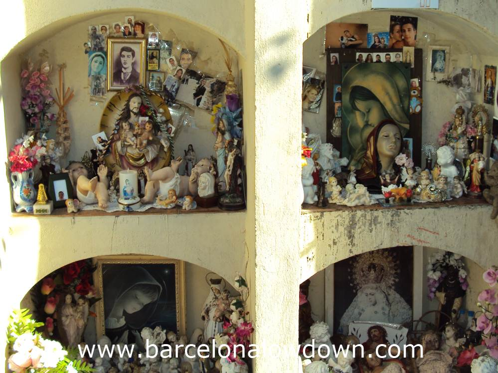 Flowers, pictures and figurines left as offerings at the grave of the little saint in Barcelona's Cemetery of Poblenou