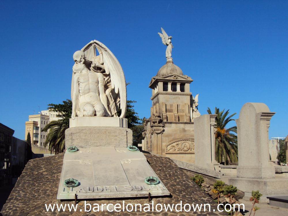 Photo taken in the Cemetery of Poblenou with the kiss of death in the foreground