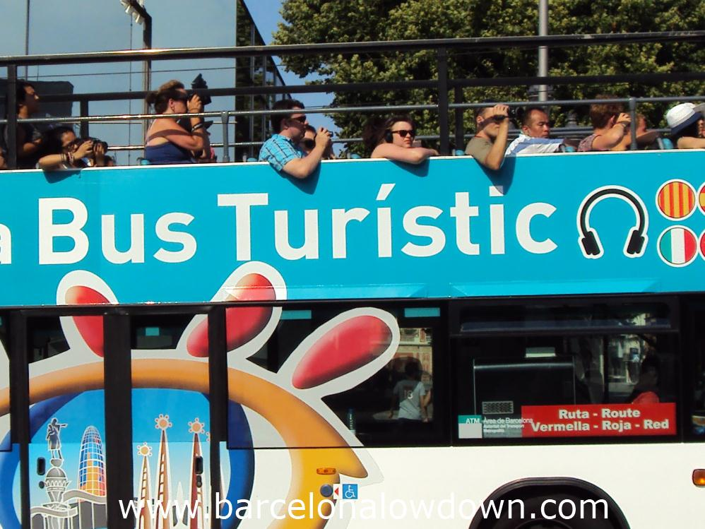 A Hop On Hop Off tour bus full of tourists in Barcelona