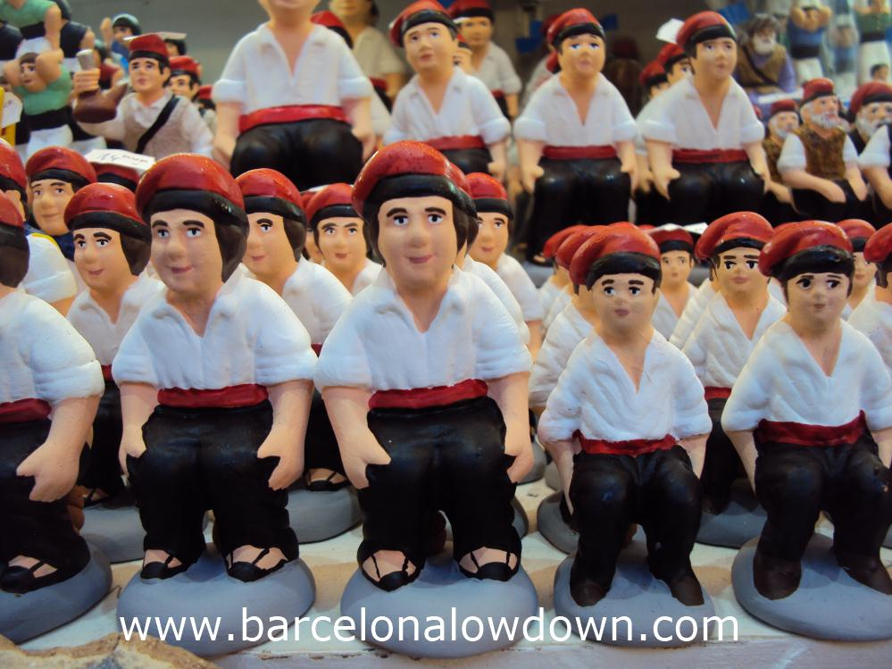 Rows of caganers for sale at a Christmas market
