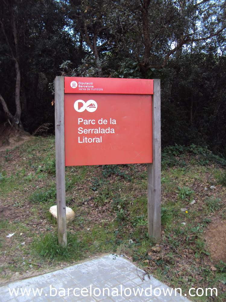 A red signpost at the start of the path leading to Burriac castle near Barcelona