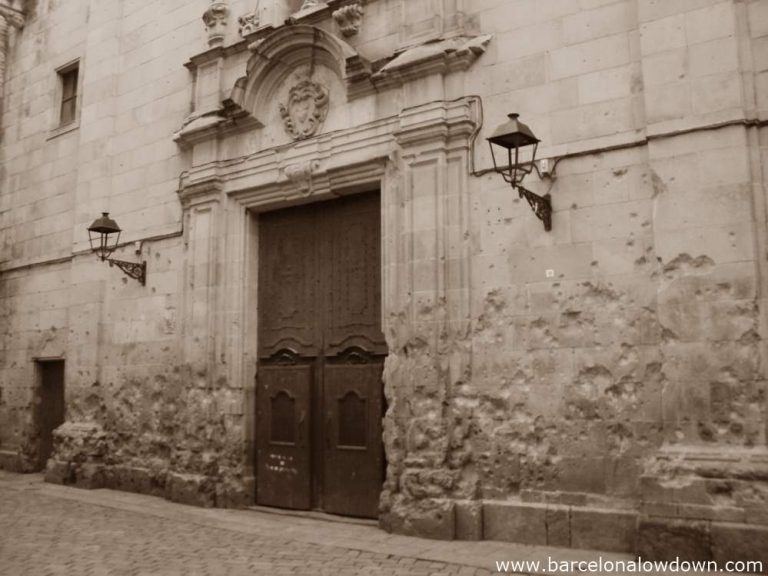 The walls of the church of Sant Felip Neri which were badly damaged by bombs during the Spanish Civil War