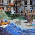 The three kings arriving at Barceino by boat in the giant nativity scene in Barcelona's Saint James' square.