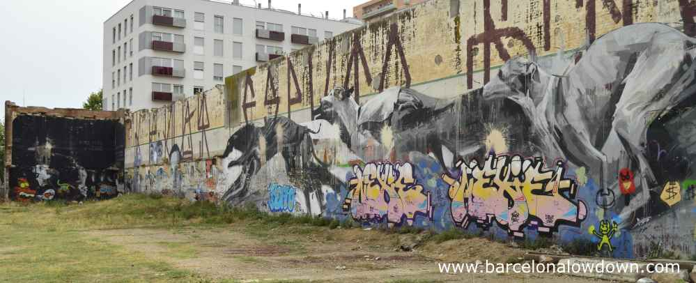 Huge graffiti of greyhounds running in Barcelona