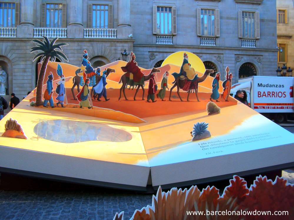 The three wise men portrayed pop-up-book style in Barcelona's annual nativity scene in front of the town hall.