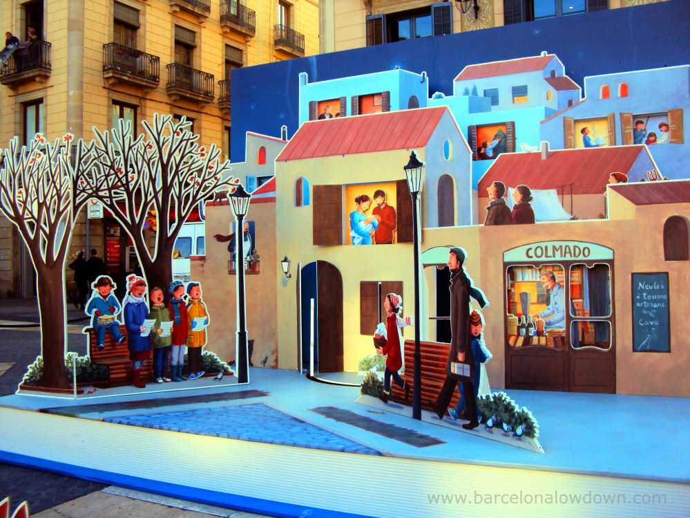 The original story book style nativity scene includes mother and child and carol singers