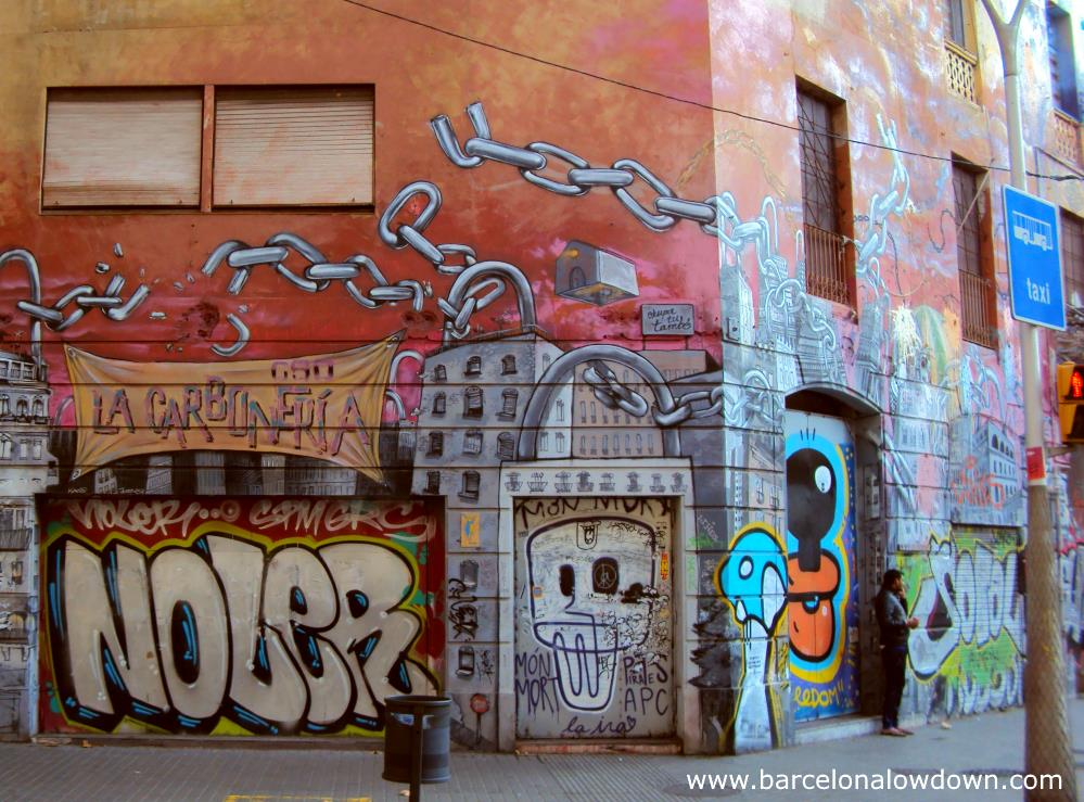 Street level view of the graffiti covered carboneria squat on the corner of Urgell street and Floridablanca
