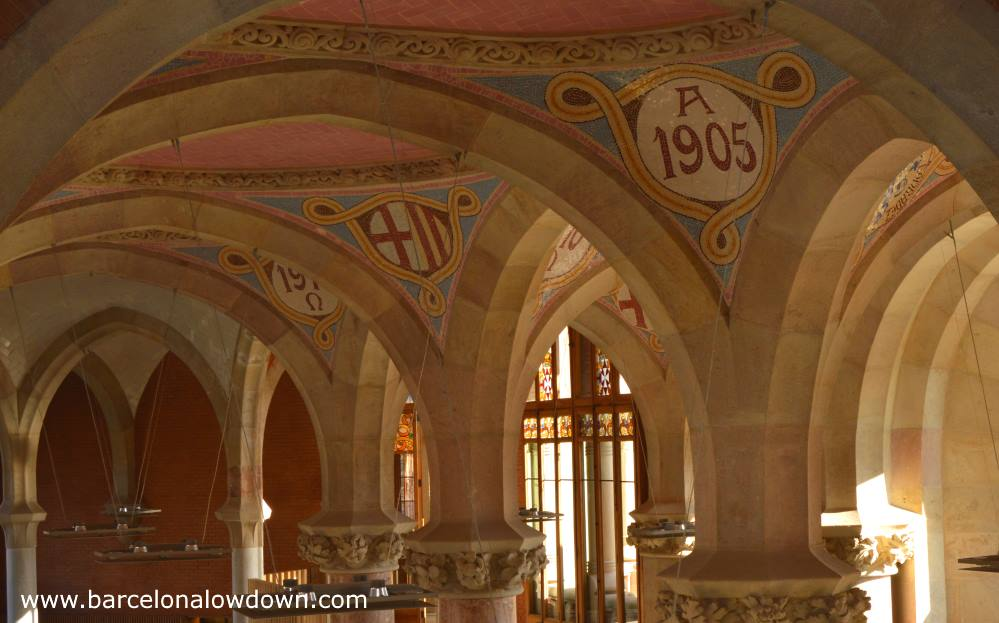 Art nouveau styled stone arches, pillars and pink tiled ceilings in the Sant Pau Art Nouveau site