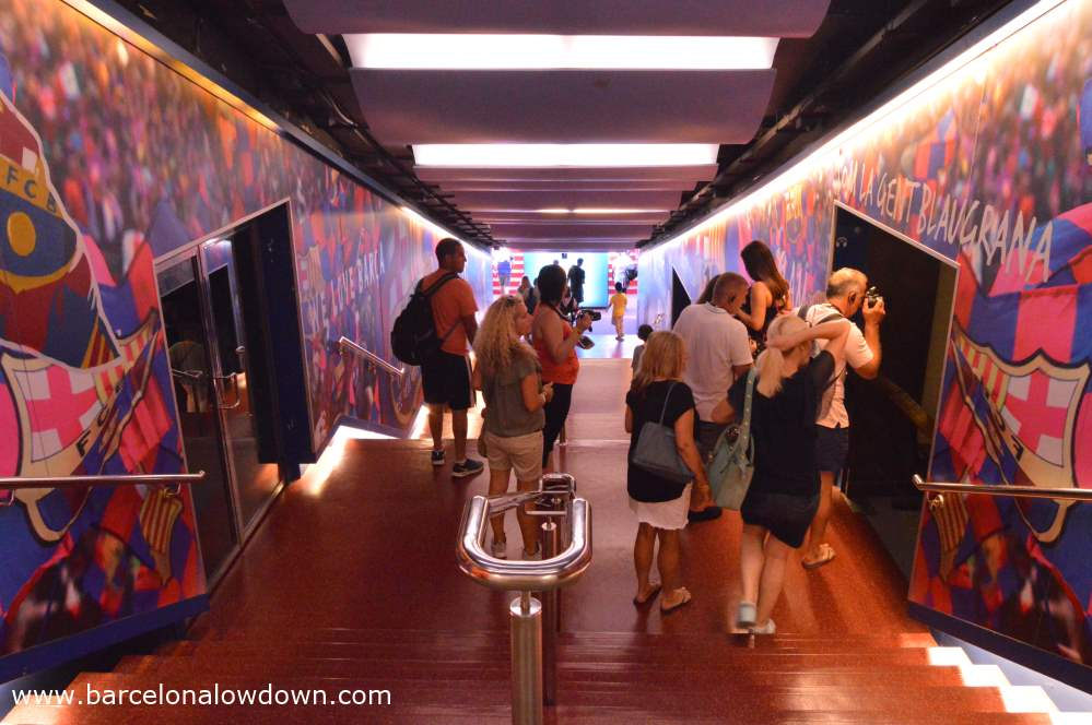 Tourists taking photos in the tunnel which leads out to the pitch at FC Barcelona football ground. Part of the Camp Nou experience tour.
