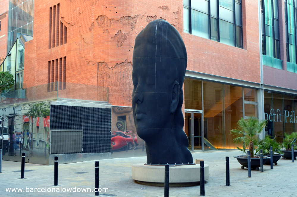 Carmela, the 2D statue of a young girl's head in front of the Catalan Music Palace in Barcelona's Gothic Quarter