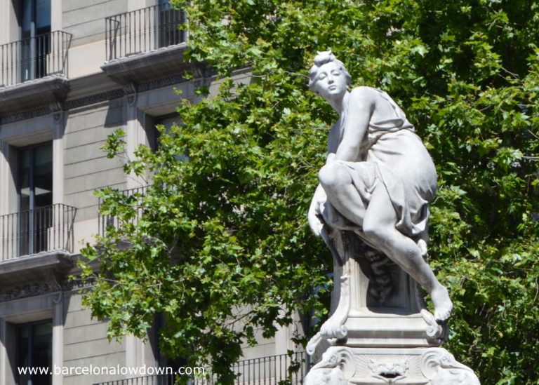 Close up photo of Diana the Huntress in front of leafy trees on Gran Via Barcelona
