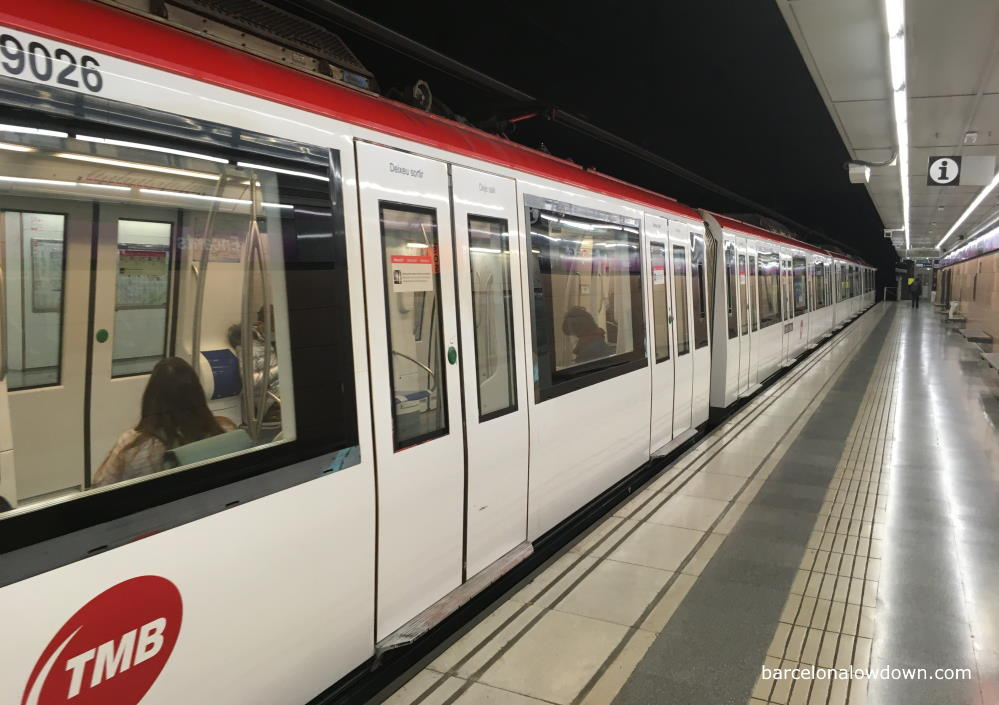 A train arriving at a station on the Barcelona metro system
