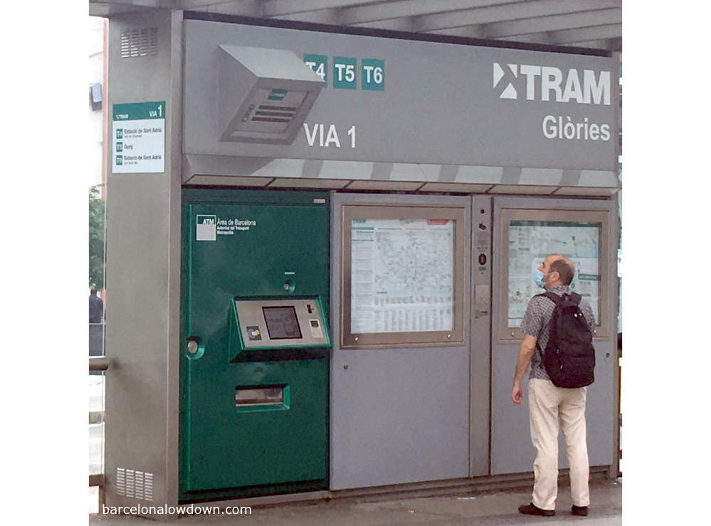 A man checking when the next tram arrives in Barcelona